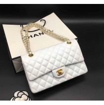 Chanel Small Classic Flap Bag in White Lambskin with golden hardware
