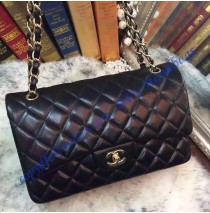 Chanel Jumbo Classic Flap Bag in Black Lambskin with golden hardware