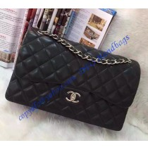 Chanel Jumbo Classic Flap Bag in Black Lambskin with silver hardware