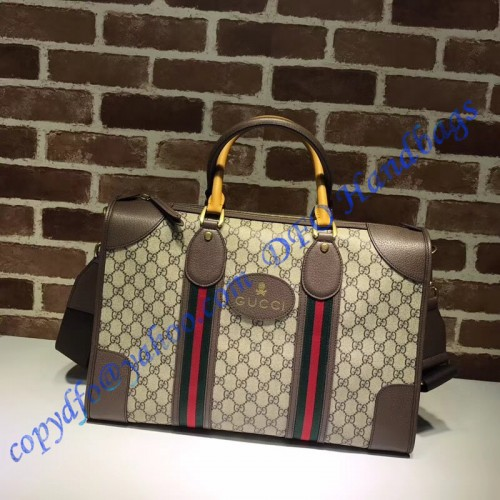 4a3b0123f82 Gucci Soft GG Supreme duffle bag with Web and brown leather trim. Loading  zoom