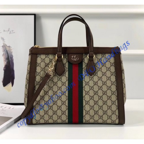 ce3eb80b6e5 Gucci Ophidia GG medium top handle bag in Supreme Canvas. Loading zoom