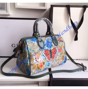 Gucci GG Supreme top handle bag with embroideries and green leather trim