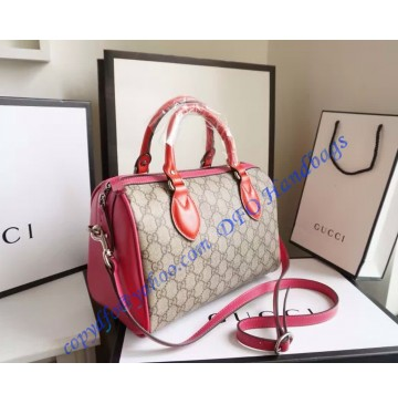 Gucci GG Supreme top handle bag with red and pink leather detail