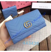 Gucci GG Marmont continental wallet in Blue leather with a chevron design