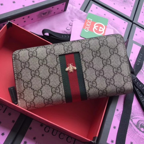 933e8ca5f16ed Gucci Web GG Supreme zip around wallet. Loading zoom