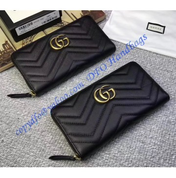 Gucci GG Marmont zip around wallet in Black leather with a chevron design