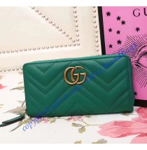 Gucci GG Marmont zip around wallet in Green leather with a chevron design
