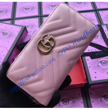 Gucci GG Marmont zip around wallet in Pink leather with a chevron design