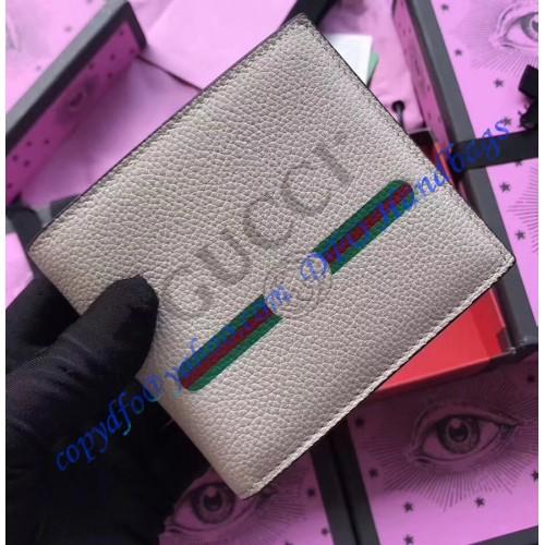 1ef19eeef3f Gucci Print Beige leather bi-fold wallet. Loading zoom