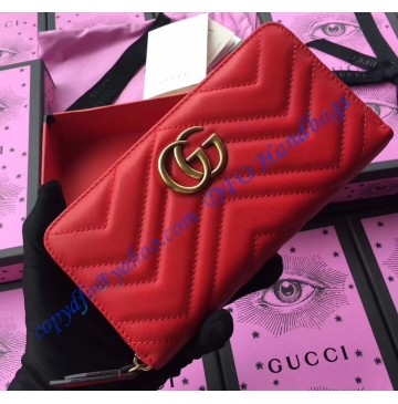 Gucci GG Marmont zip around wallet in Red leather with a chevron design