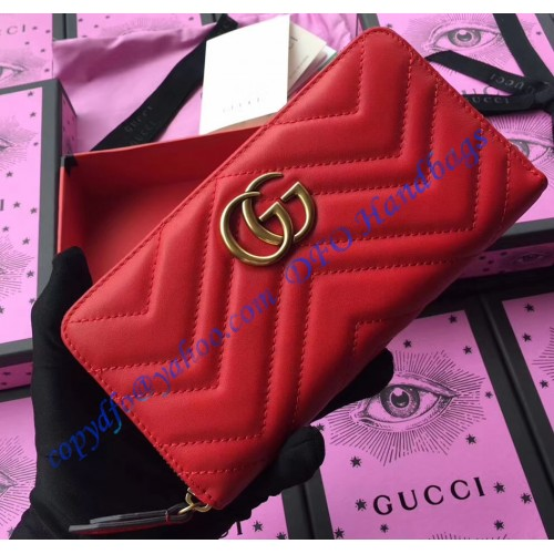 a90611a73c7 Gucci GG Marmont zip around wallet in Red leather with a chevron design.  Loading zoom